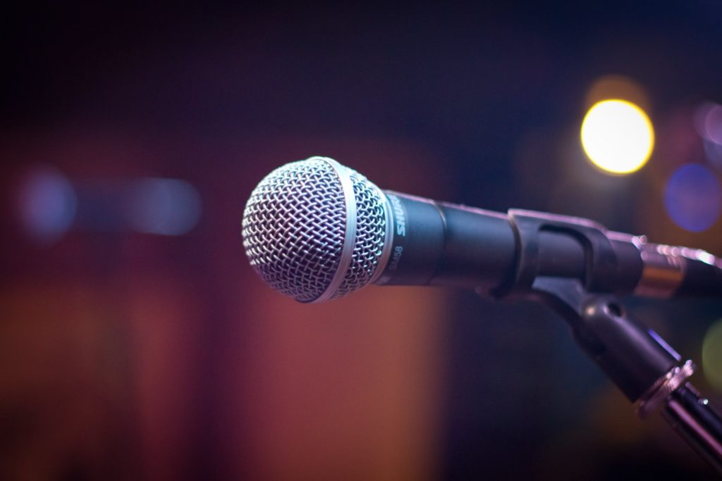 Zoomed in photo of a microphone on a stage